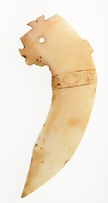 ceremonial blade; ivory white jade; blade with curved handle with limited decor except projecting flanged (may be depicting the silhouette of a bird) and incised design of parallel and diamond in band; traces of red pigment