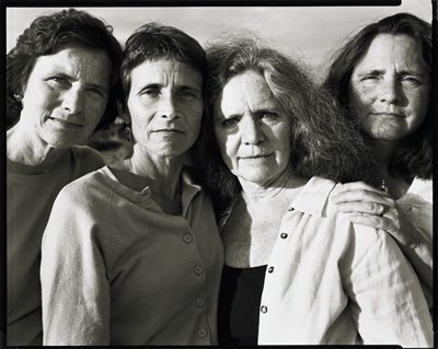 four middle-aged women-two with long hair at R, two with short hair at L; figures close together