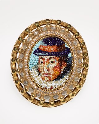 large oval domed portrait of John Smith in multicolored beads; diamonds around rim in two rows; portrait of Pocahontas in multicolored beads on inside; two-part band with pear shaped greyish stone on each side of band and faceted diamond at palm side