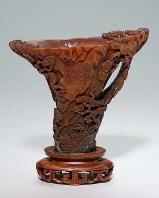 rhinoceros horn cup on carved teakwood stand