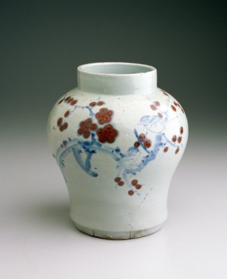 vase baluster-shaped, short straight neck and wide mouth, decorated with underglazed blue and copper-red glaze of prunus, birds and bamboo; porcelain