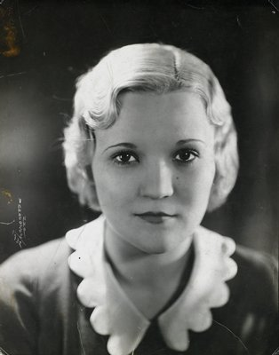 portrait of a blond-haired women wearing white scalloped-edge collar
