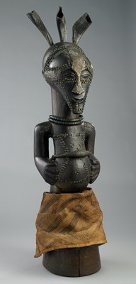 male figure; wood, horn, brass tacks, metalwork, glass, beads, fiber and leather