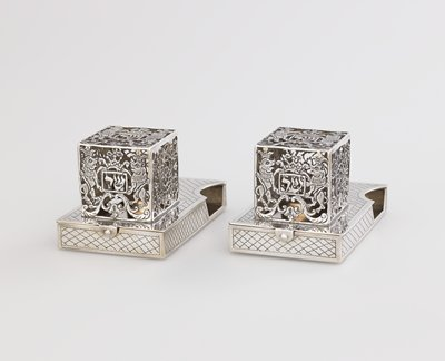 small rectangular case with hinged lid; square filigree 'cage' with floral designs and 2 panels of paired crowned lions; scalloped grid incised overall