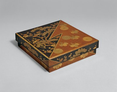 lacquered writing box with heavily decorated cover and sides; zigzag down center divides pine tree with plum blossoms against a black background, from motif of chrysanthemums and leaves against reddish background; motifs continue on sides; ink stone and two empty boxes inside