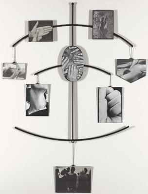 eight, black and white images affixed to black metal plates, hanging from and attached to thin, black rods; frame structure consists of one vertical rod with three, slightly curved horizontal rods intersecting at mid points; upper rod has two fixed images (hands; landscape) and two hanging images (hands around neck; nude body); middle rod has one fixed image (hands on hairy body) and two hanging images (neck; fist); bottom rod has one hanging image (crowd of people, seen from behind)