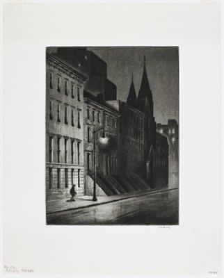 street scene at night; buildings left; streeet foreground; single street light left; man walking into pool of light