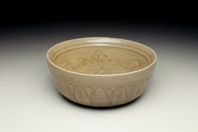 shallow bowl fused to the rim of a deeper bowl with open foot; incised with a floral design in the center and a lotus leaf pattern around the outside