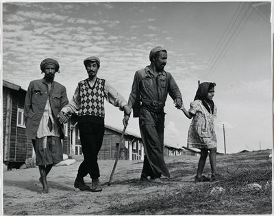 black and white photograph of three men and a young girl