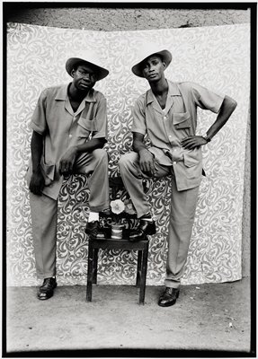 Untitled (two friends dressed in three-pocket bush suits)