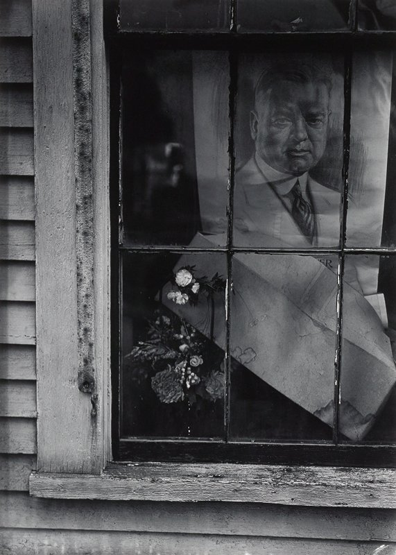 sketched portrait of a man, water-spotted envelope and flowers seen through a window