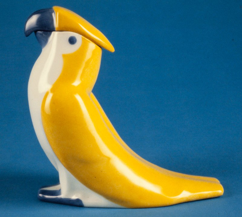 decanter in shape of parrot with lid, top of head forms removable lid; Arte Moderne style; white yellow and blue glazes
