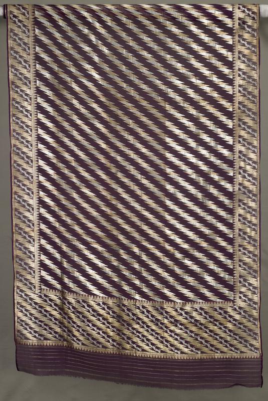 Banaras brocade; drawloom; art deco pattern; tissue ground; silver and gold diamond diagonal pattern on sheer purple ground
