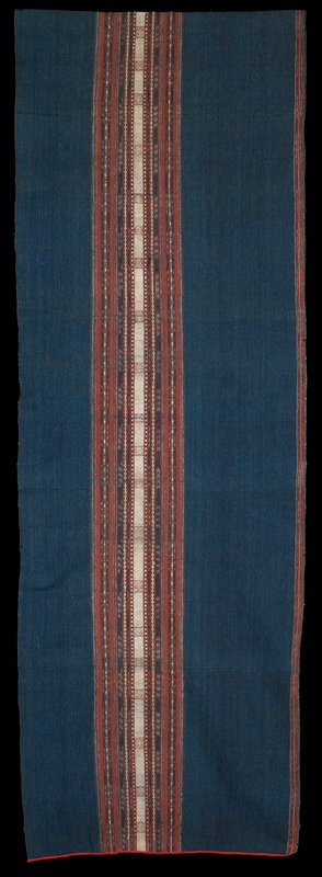 blue with rust, variegated blue and cream stripes on one long side; central strip in same colors with plain and decorative geometric pattern stripes; red trim at short ends
