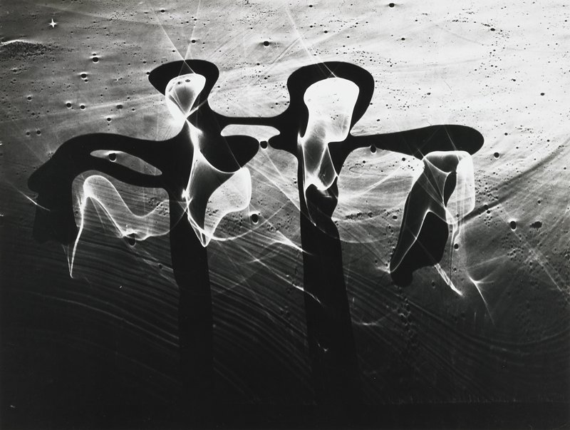 two dark abstract figures, wing-like appendages, textured background with bubbles and striations