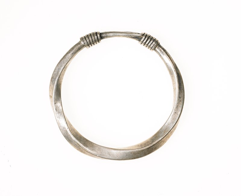 closed circle; bangle-type bracelet of one piece of twisted metal; wire wrapped to hold piece together; wire is part of single piece of metal used to make bracelet