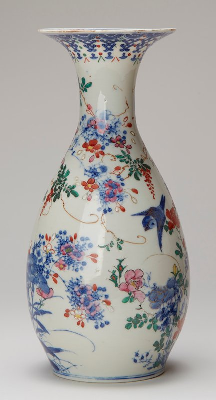 white with cobalt blue and overglaze enamels in orange, pink, green, black, brown, yellow and white and gold details; two small blue birds and heavy multicolored flowers and foliage; trumpet mouth, one of a pair