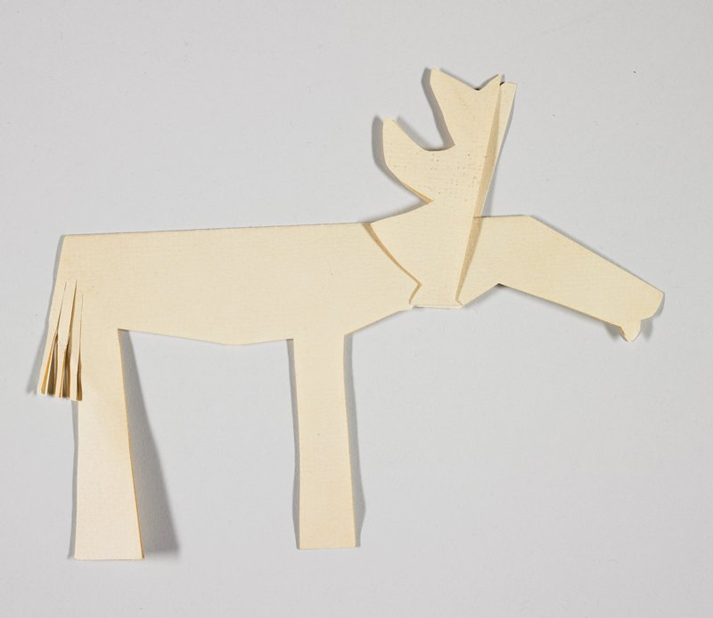 pattern for birch bark cut outs; tan cut-out paper in the form of a moose