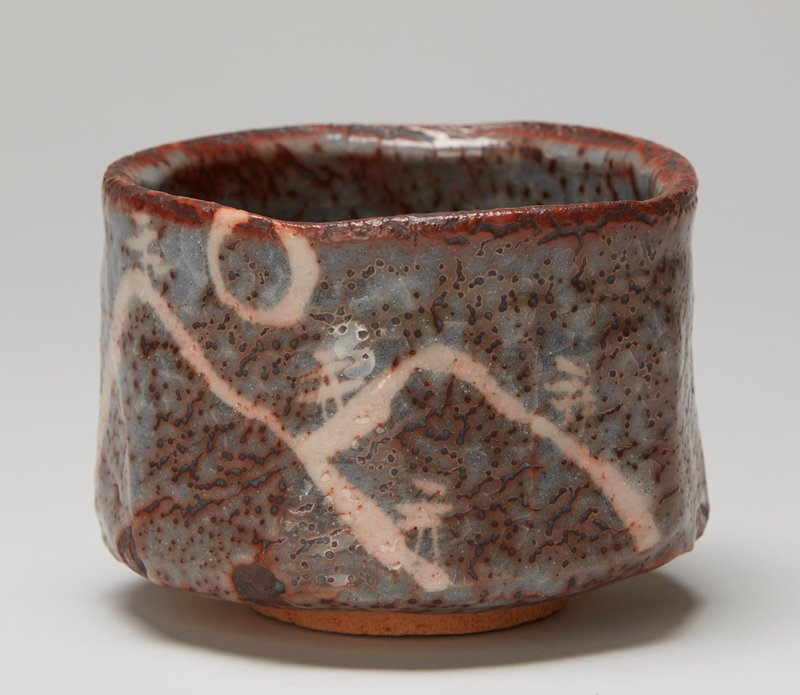 tea bowl; large; ring foot; straight sides; sides lightly articulated into planes; chocolate brown and blue-grey glazes with pink sketchy abstract landscape on exterior on one side