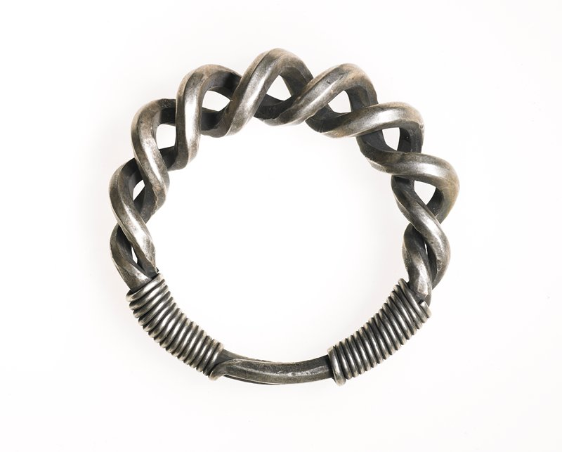 one of a pair of bracelets; main body made from loosely coiled, thick, square wire; ends of wire are wrapped in thinner square wire