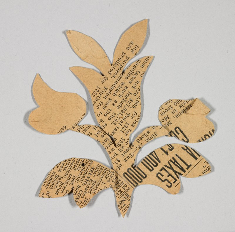 three flowers with stem and leaves in symmetrical design; printed newsprint