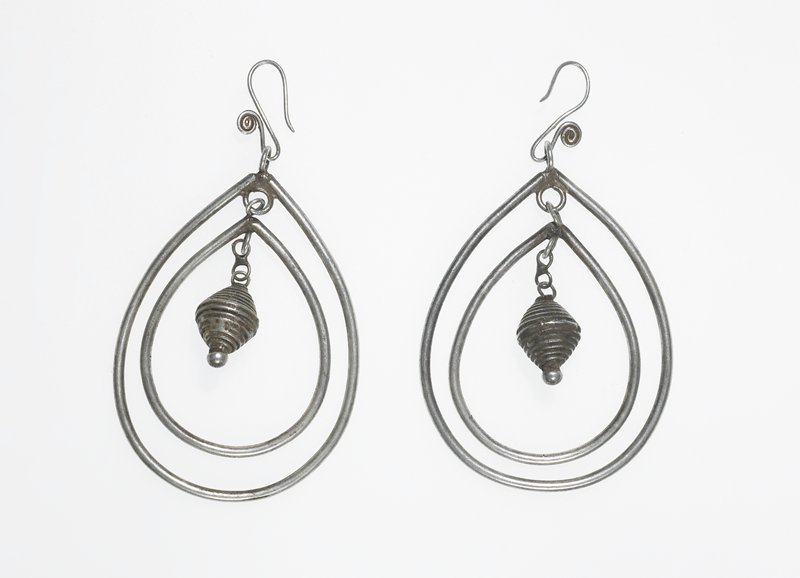 pair of earrings; each is two oval hoops; hoops have a double-sided cone dangling down in the center; ear piece is S-shaped wire with a curlicue on one end
