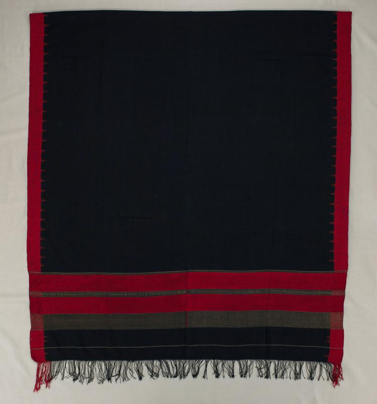 dark blue with red edging with triangles; ends woven with metallic stripes; fringe at short ends