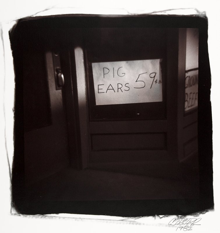 "sign on door: ""Pig Ears 59 cents each"""