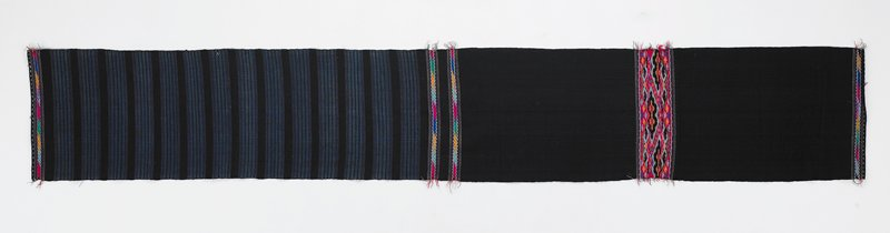 dark blue with lighter blue stripes on half; four bands of embroidered and woven multicolored chain designs; one wider band of geometric and linear multicolored embroidered and woven designs