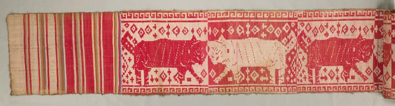 predominately dark pink and white; woven with pairs of tigers facing one another, in alternating colors; key design borders; purple, orange, green stripes at ends; braided tan tassels at one short end