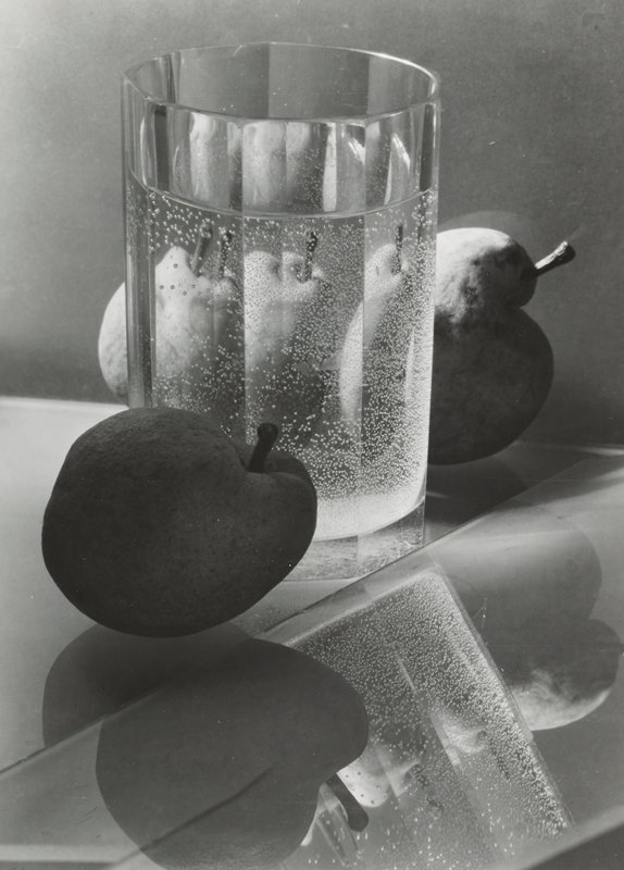 clear glass with clear liquid with bubbles; three fruits
