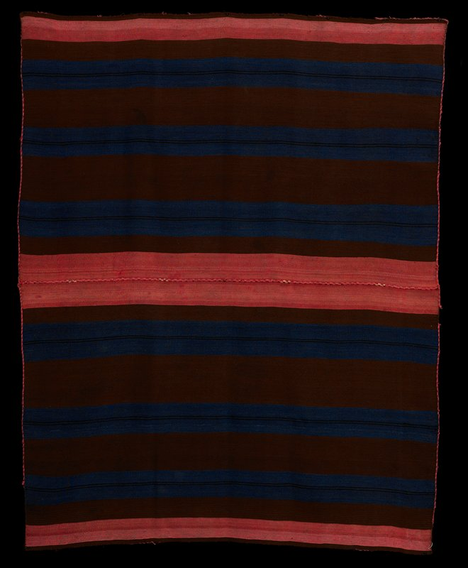 two pieces sewn together; pink edging; each piece has brown stripes and three blue stripes-each blue stripe with two thin black stripes; wide pink stripes at ends; warp faced plain weave