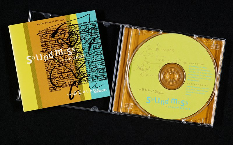 compact disc in jewel case with liner notes; cover art: vertical bands of brown, dark orange, lime green and blue ground with typeset paragraph at left, running off edge; black lines and scribbles over text