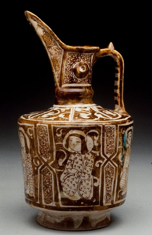 Ewer, white with gold luster decoration. On body seated figures separated by polygons. Arabesques on neck.