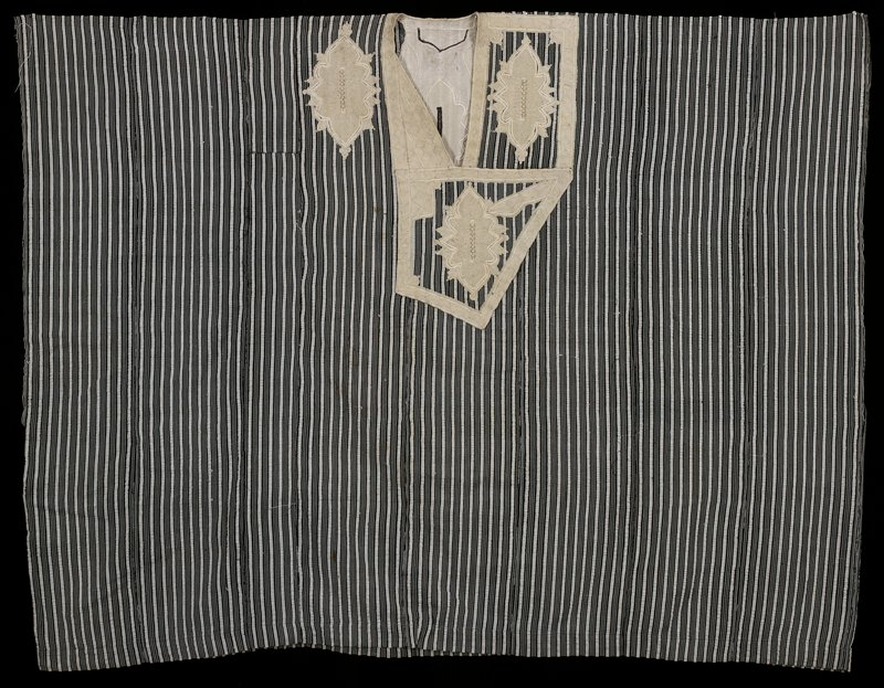 black and white stripes; elaborate tan embroidered collar, front and back