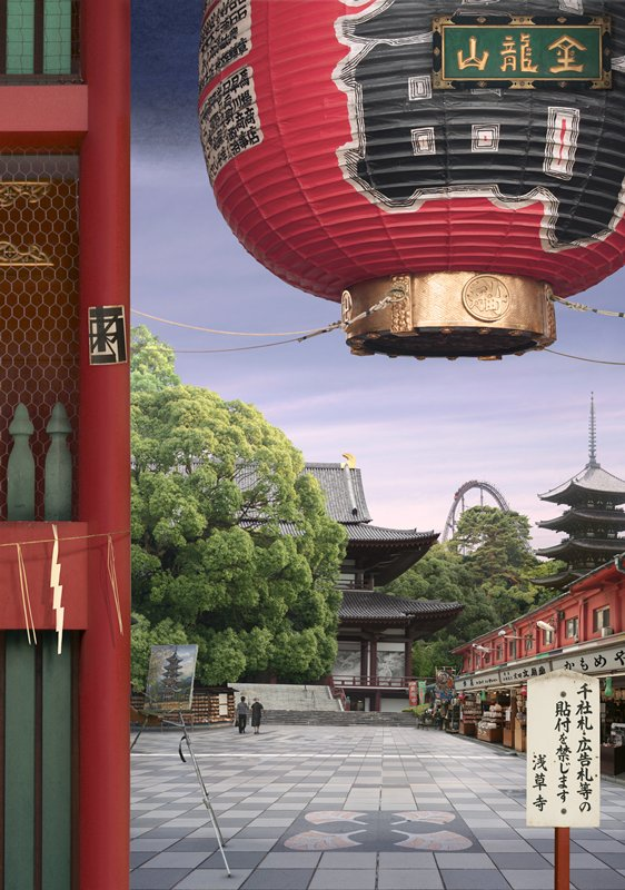 tiled ground of outdoor temple complex in foreground and middle ground; temples and roller coaster in background; red lantern at top R; black metal frame on light box
