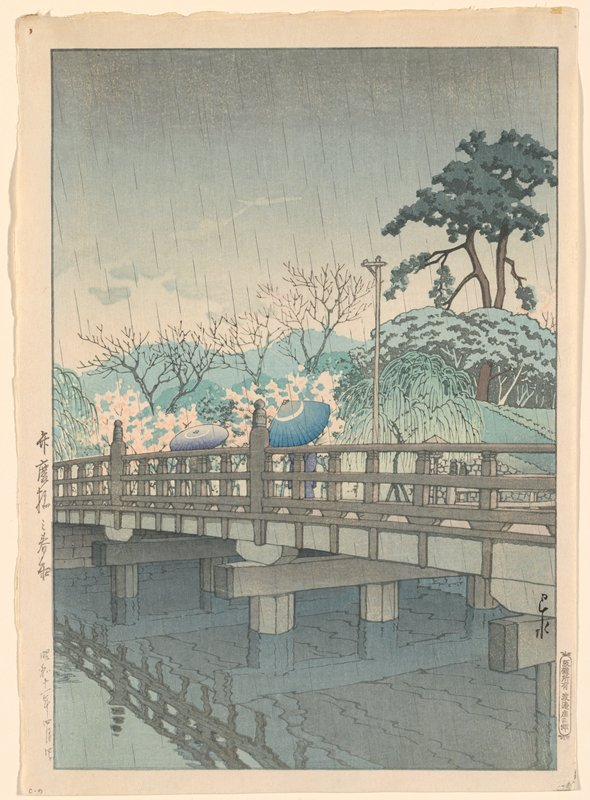 bridge with umbrellas (blue and purple with white) held by figures on bridge visible over railing; trees on opposite side of bridge; grey sky with rain falling