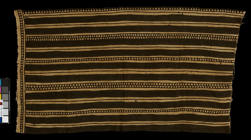 tan and black textile decorated with stripes and rows of squares; constructed of seven long strips; stripes of textile run parallel to the longer edge of textile