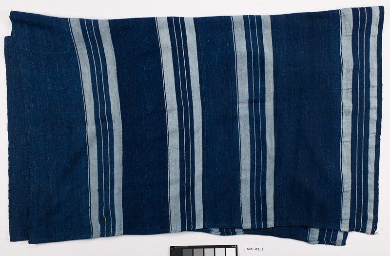 dark and light blue striped cloth; 5 panels of different widths; pattern: wide solid dark blue section followed by light and dark blue stripes of varying widths; repeat pattern