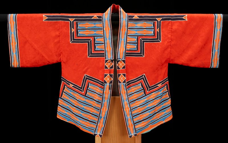 silk damask, red orange ground with blue and orange Ainu-type motifs