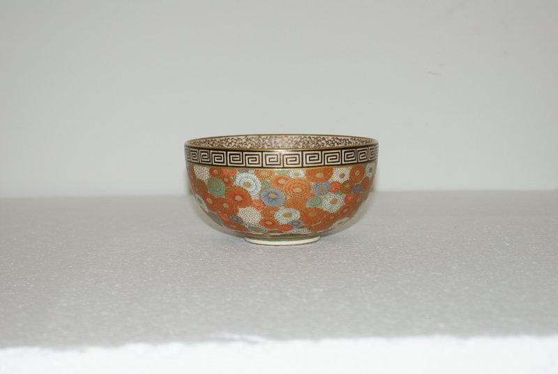decorated in polychrome enamels and gilt with chrysanthemum motif; Greek key-frets around lip; tiny butterflies inside