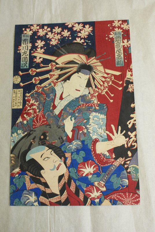 left print: two actors in center; one actor dressed as a woman with ornate kimono and headdress clutches kimono with PL hand and looks toward PL; actor at bottom has shadow of a moustache and wears a kimono decorated with morning glories; sword under PL hand; actor reels back thrusting PL hand in front; background with cartouches, flowers