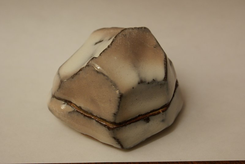 dome-like ceramic box with sculpted, irregular edges; mauve and white glaze