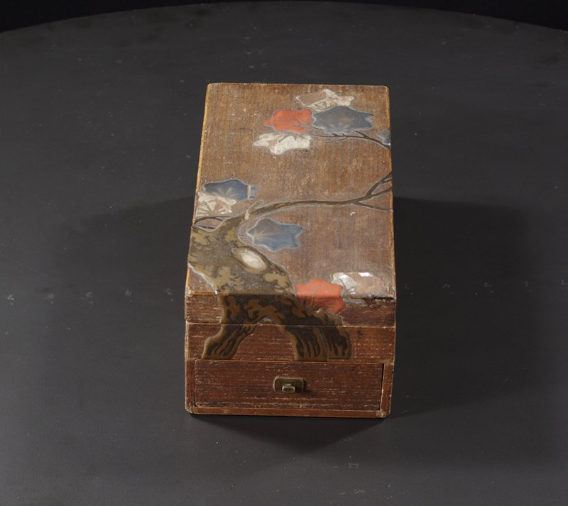 rectangular writing box with maple tree design; sparse red, pewter, and mother-of-pearl leaves; small drawer with pull; stylized deer inside cover