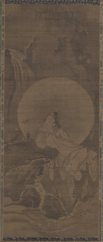 figure seated on rocks, with elbows resting on rock and head resting on back of PL hand, contemplating a small plant in a vase; water in foreground; mountains and tree in background; ivory roller ends