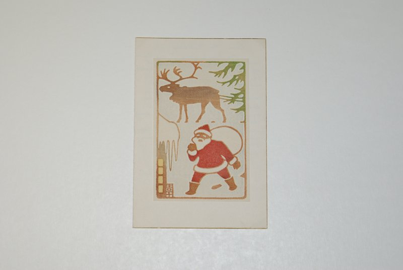 """Santa Clause at LR walking towards portion of icicle covered house, carrying white bag over PR shoulder; reindeer in profile standing at top; portion of pine tree at UR frames image; inside: red block printed message, """"Best Wishes for a Merry Christmas and A Happy New Year"""""""