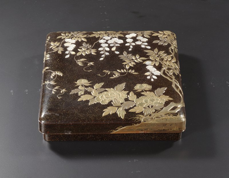 lacquer writing box with blossoming wisteria vines growing from R in gold and mother-of-pearl; large blossoming peonies LRC; inside a Chinese-styled lion chases a blue and gold butterfly amid grassy landscape with peonies