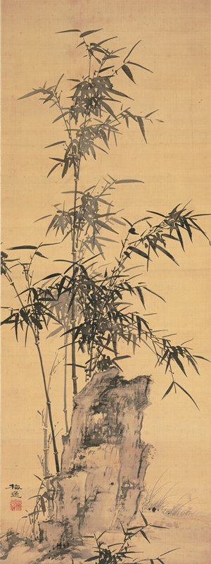 rock at bottom center with several tall, thin bamboo sprigs growing from behind; shorter grasses and foliage around rock