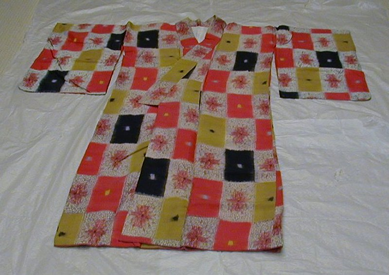 Kimono with red, yellow, black and white recutangular motifs