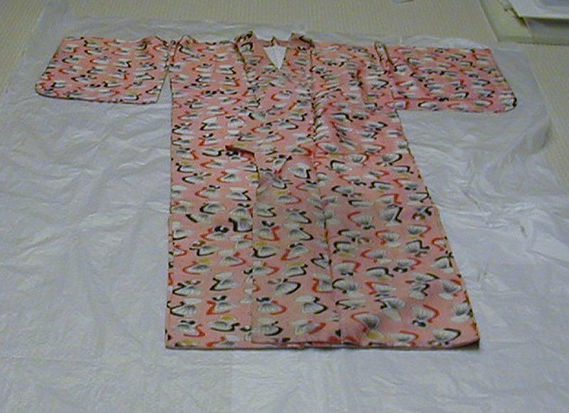 pink silk kimono with open shell motif; shells have red or black shadow and some have brown, yellow, or white bottoms